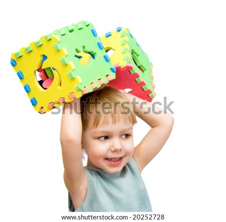 a child plays with toy blocks. isolated on the white