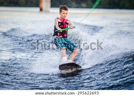 A child riding in the Wakeboarding #295622693