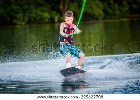 A child riding in the Wakeboarding #295622708
