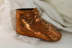 A child's bronzed baby shoe