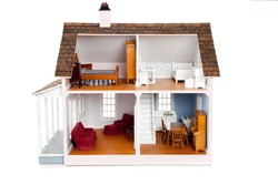 A Child's doll house with furniture on a white background