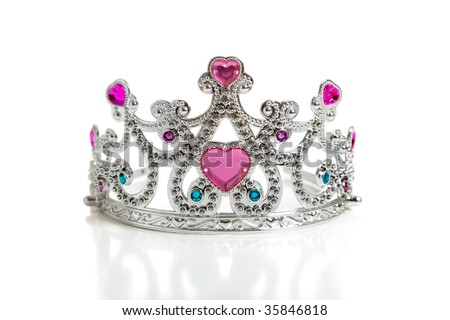 A child's toy princess tiara on a white background with copy space