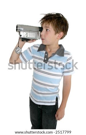 A child standing and filming with a handheld video camera