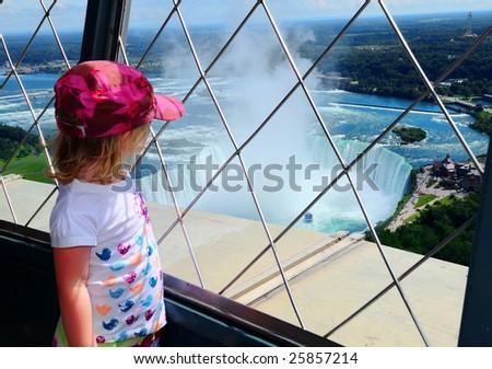 A child views Niagara Falls, Ontario Canada from tower.