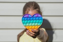 A child with a colorful game
