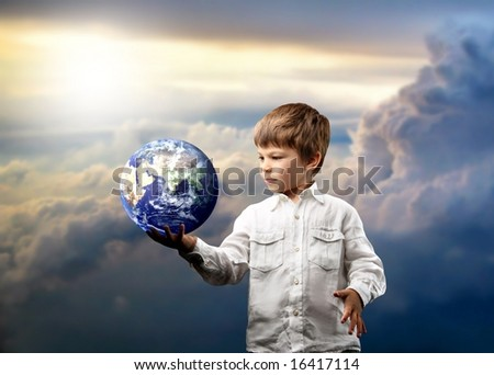 a child with a globe - stock photo