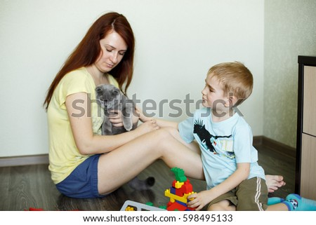 A child with her mother is playing a designer