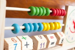 A childs abacus and numberic blocks to represent the subject of learning math
