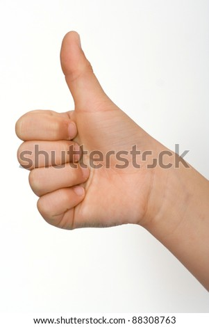 A childs hand with thumb up