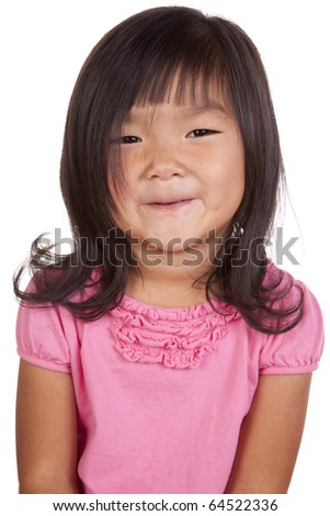 A chinese girl is posing and smiling.
