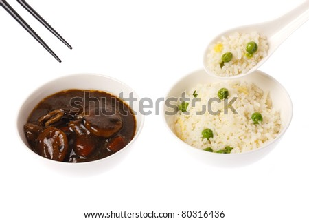 A chinese meal consisting of beef and black bean and fried rice on white back ground