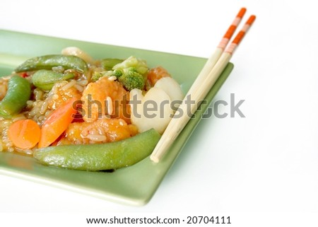 A Chinese plate of chicken and vegetables with rice and chopsticks.  All isolated on white with room for copy space.