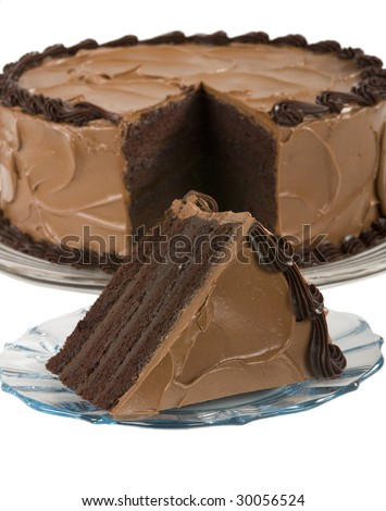 A chocolate cake with a slice cut