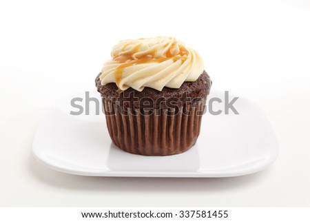 A chocolate cupcake in a plate. #337581455
