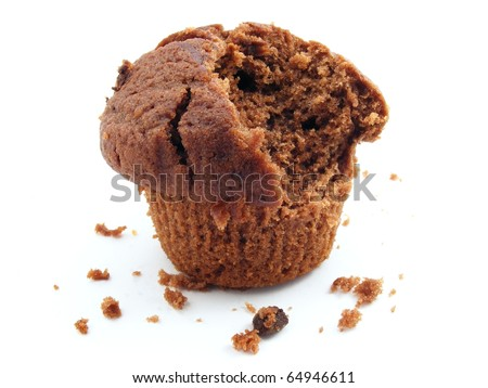 A chocolate muffin on a white background with a bite taken out of it.