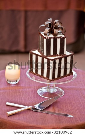 A Chocolate Wedding Cake with Cutting Knifes
