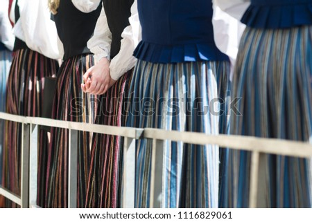 A choir standing in line for Latvian Song and Dance Celebrations. Women dressed in traditional folk costumes