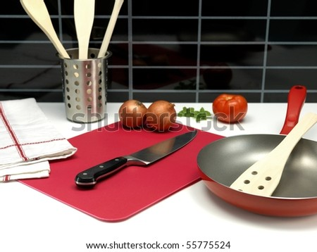 A chopping board on a kitchen bench