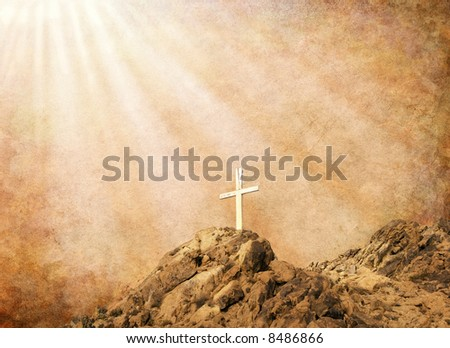 A Christian cross with spiritual light and sepia textures.