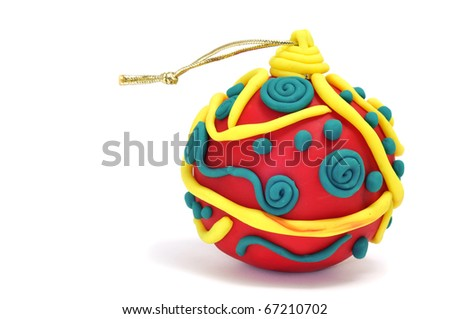 a christmas ball made with modelling clay on a white background