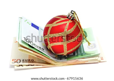 a christmas ball with euro bills symbolizing consumerism