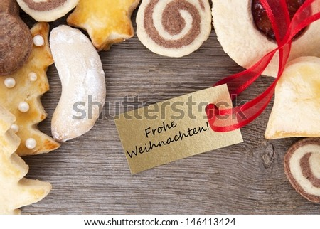 Christmas cookie background with the german words frohe weihnachten