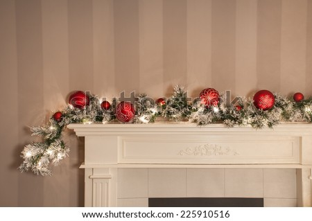 a christmas garland / sitting on a mantelpiece / looking all festive