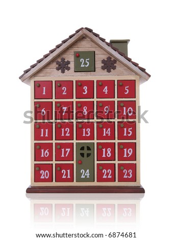 A Christmas house counting the days to Christmas over white - stock photo