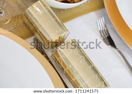 A Christmas place setting on a nicely set dining table