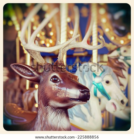 A Christmas reindeer on a carousel ride. Processed  and filtered to look like an aged instant photo.