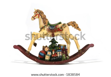 A Christmas rocking horse with presents underneath