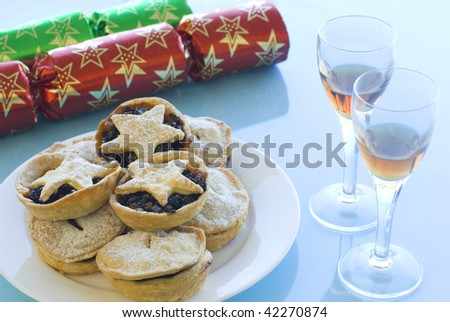 a Christmas still life with mince pies, glasses of sherry and crackers