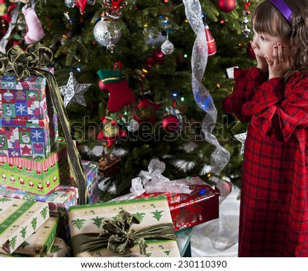 a christmas surprise / a really lot of presents / surprised little girl