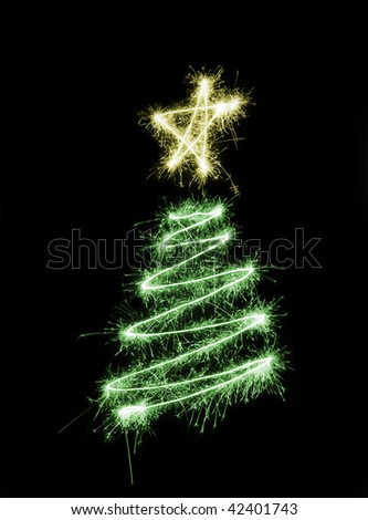 a christmas tree drawn in sparkling light trails