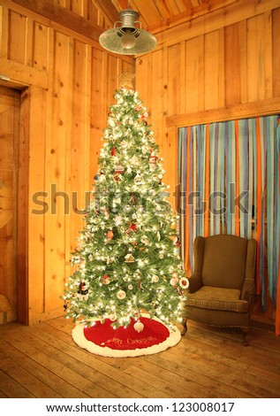 a christmas tree in a barn, set up for a celebration party