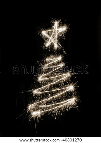 A christmas tree symbol drawn in sparkler trails
