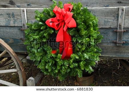 A Christmas Wreath on an old Farm Wagon
