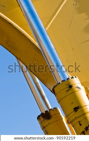 A Chrome Hydraulic Cylinder on Construction Equipment