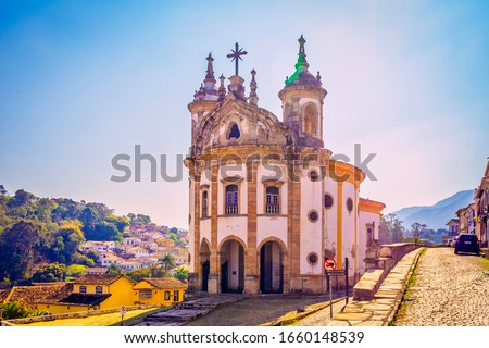 A church at Ouro Preto, Minas Gerais, Brazil. Ouro Preto is former capital of the state of Minas Gerais, Brazil. This city used to be a very rich city from gold mining. Locals said the ornaments of th