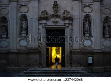 A church in Lecce (Italy). Door is opened and the golden light invites to enter.