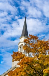 A church steeple with autumn colored leaves in Salem, Oregon