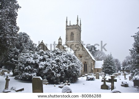 a church yard in Gloucester with snow on the ground