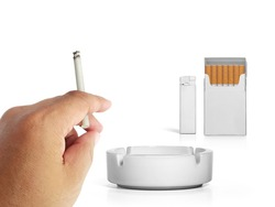 A cigarette in a hand, Cigarette pack, ashtray, and lighters isolated on white background