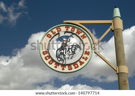 A circular sign showing Old Town in Scottsdale, Arizona