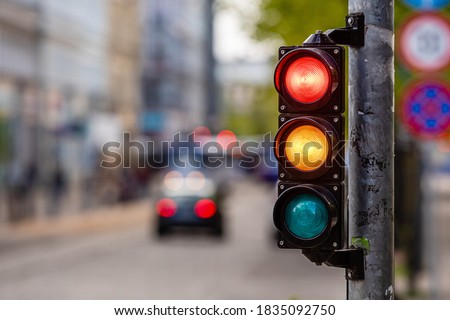 a city crossing with a semaphore, red and orange light in semaphore, traffic control and regulation concept Сток-фото ©