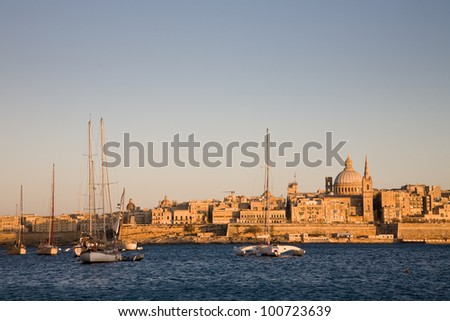 A cityscape of La Valletta in Malta at dusk