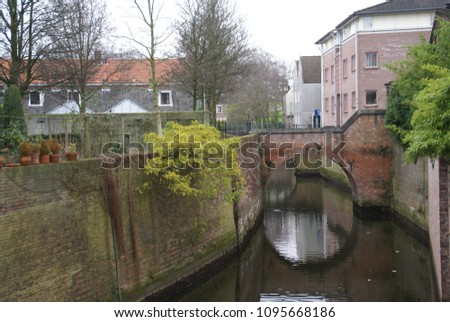 a cityview of 's-Hertogenbosch with canal #1095668186