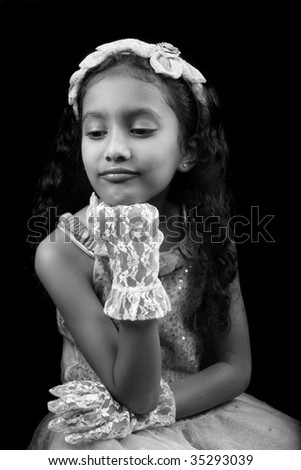 A classic black & white, fairytale-like picture of a pouting sad Indian princess.