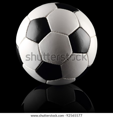 a classic black white soccer ball on black background
