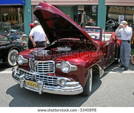 A classic car displayed at a street antique car show